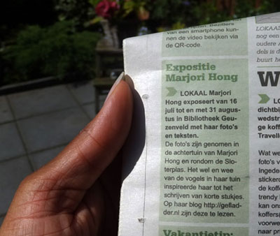 Aankondiging expo Gefladder/Marjori Hong in Stadsblad De Echo
